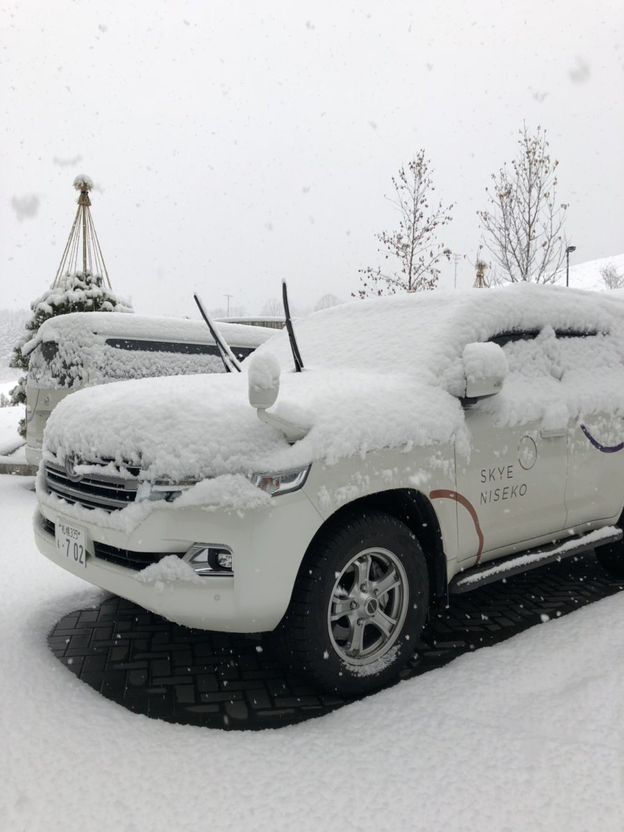 Skye Niseko Car With Heavy Snow