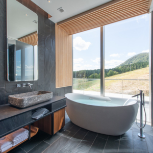 See the stunning summer landscape from your bathtub.